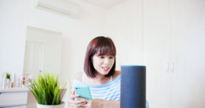 woman talking to smart speaker